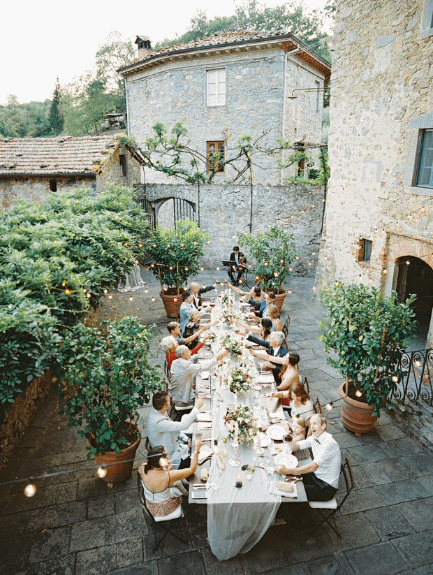 Guests celebrate and charge their glasses at a micro wedding.