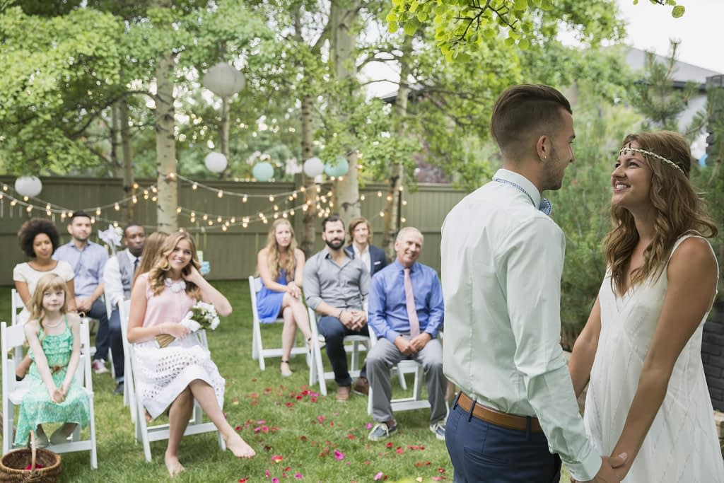 Couple tie the knot in their back garden due to restrictions on guest numbers as a result of the pandemic.