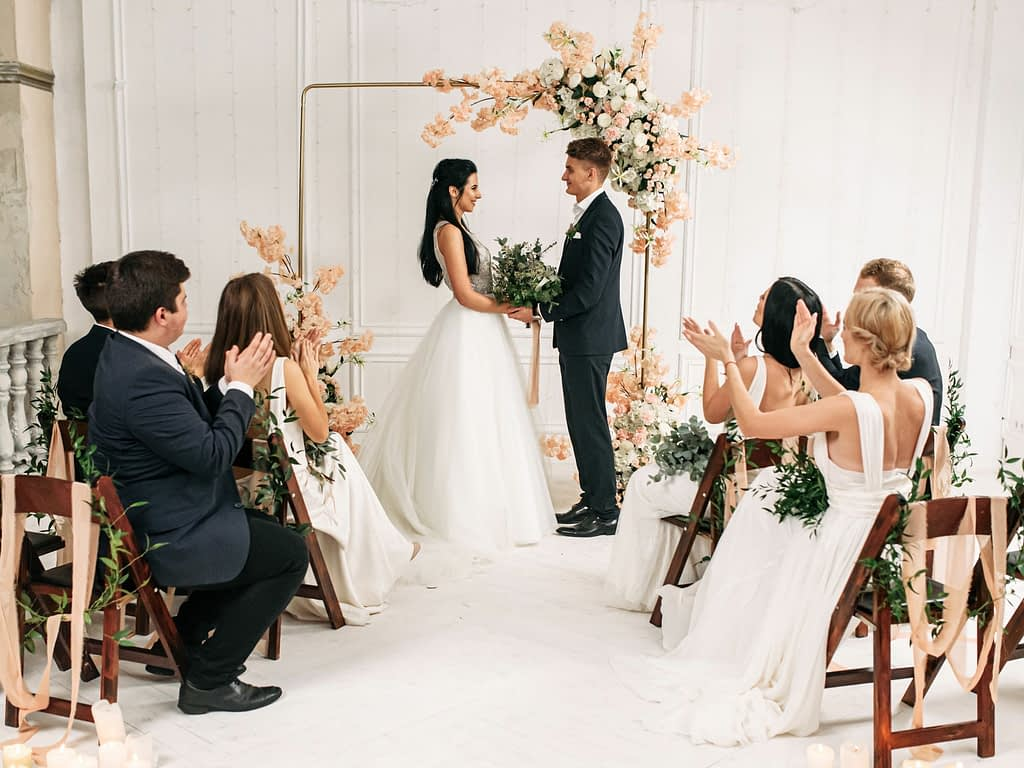 Couple tie the knot in front of their guests at their intimate celebration.